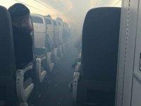 İçerisi dumanla dolan yolcu uçağı acil iniş yaptı: Yaralılar var