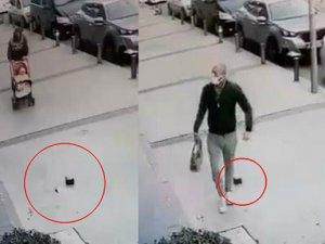 Bebek arabasıyla giderken yerdeki para dolu cüzdanı alıp, kaçtı